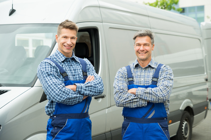 Two Happy Repairmen In Overall With Arms Crossed In Front Of Van